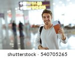 travel the world. handsome male ... | Shutterstock . vector #540705265