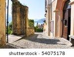 Narrow street of Menaggio town at the famous Italian lake Como - stock photo
