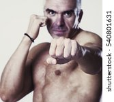 Small photo of Aggressive fighter or boxer ready to fight.