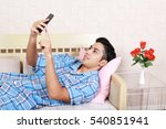 asian man holding a smart phone  | Shutterstock . vector #540851941