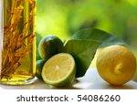 Lemons and vinegar. - stock photo