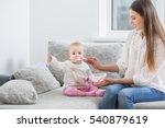 mom feeding baby indoor | Shutterstock . vector #540879619