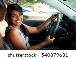 Young hispanic teenagers driving
