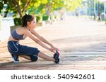 young girl warm up on the park | Shutterstock . vector #540942601