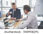 two men are smiling at work | Shutterstock . vector #540958291