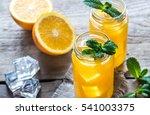 glass jars of orange juice   Shutterstock . vector #541003375