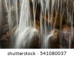 Small photo of waterfall. downflow of water on stones. water streams beautifully fall on stones