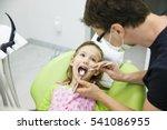 child patient sitting on dental ...   Shutterstock . vector #541086955
