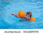 4 year old boy swimming in pool ...   Shutterstock . vector #541089595
