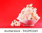 popcorn in a bowl on red... | Shutterstock . vector #541092265
