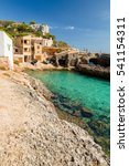 Small photo of Cala s'Almonia, beach with small fishermen houses. Mallorca. Spain.
