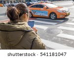 the girl use the phone while... | Shutterstock . vector #541181047