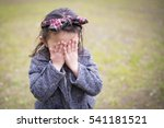 Stock photo little girl to hide her face with hands 541181521