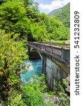 Small photo of Landscape in Abkhazia with the stone bridge over river