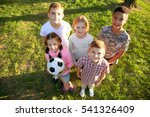 Cute Kids Playing Ball Green - Fine Art prints