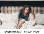smiling young mother sitting in ... | Shutterstock . vector #541344925