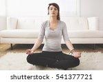girl meditating in her living... | Shutterstock . vector #541377721