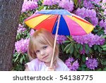 Little Girl Holding A Colorful...