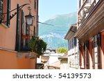 Narrow street of Bellagio town at the famous Italian lake Como - stock photo