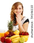 Beautiful young woman and fruits on the table - stock photo