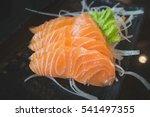 salmon raw sashimi on black... | Shutterstock . vector #541497355
