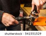 barista presses ground coffee... | Shutterstock . vector #541551529