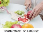 young happy woman cutting... | Shutterstock . vector #541580359