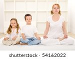 Family - woman and kids - relaxing with yoga exercises indoors - stock photo