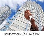 a hand is holding a key from... | Shutterstock . vector #541625449