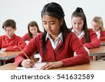 female pupil at desk taking... | Shutterstock . vector #541632589