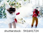 Couple Playing Snowballs In A...
