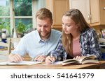 male home tutor helping teenage ... | Shutterstock . vector #541641979