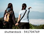 Two Woman Hold Hand Outdoor In...