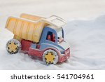 Children's Toys In The Snow