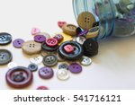 Spilled Jar Of Colorful Button...