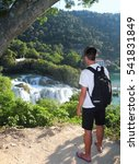 Small photo of The guy admiring the waterfalls from the top to Krka National Park.