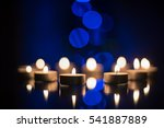 candles burning at night.... | Shutterstock . vector #541887889