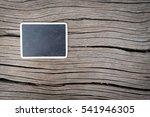 Blackboad On Wood Background