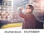 man with backpack drinking... | Shutterstock . vector #541958809
