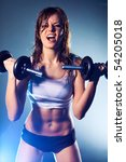 Young strong sexy woman with dumbbells. - stock photo