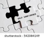 Small photo of Self - Confidence text on missing puzzle.