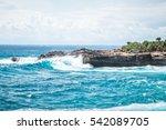 a beautiful blue wave crashes... | Shutterstock . vector #542089705