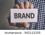 businessman shows brand card.... | Shutterstock . vector #542112235