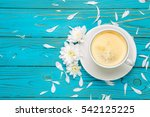 cup of coffee and flowers on... | Shutterstock . vector #542125225