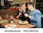attractive young couple eating...   Shutterstock . vector #542184331