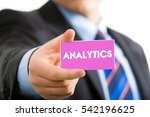 analytics word  hand holding...