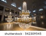Small photo of Saint-Petersburg, Russia - September 6, 2016: Huge crystal chandeliers in the large concert hall of the State Philharmonic Tchaikovsky lowered to the floor to remove dust