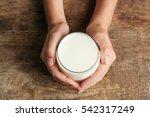 female hands holding glass of... | Shutterstock . vector #542317249