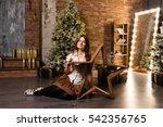beautiful woman near christmas... | Shutterstock . vector #542356765