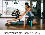 gym  she keeps feet on his... | Shutterstock . vector #542471239